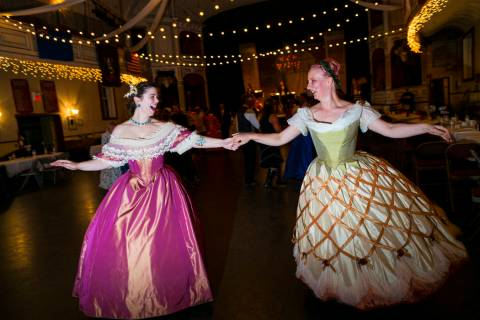 Abby Cox, of Reno, left, and Christina DeAngelo, of Sparks, both wearing custom period ballgown ...