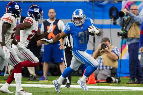 Detroit Lions running back Ty Johnson (31) rushes against the New York Giants during an NFL foo ...