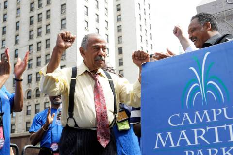 FILE - In an Aug. 24, 2010 file photo, Congressman John Conyers, left, greets the Rev. Jesse Ja ...