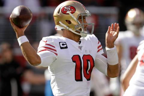 San Francisco 49ers quarterback Jimmy Garoppolo throws the ball during the first half of an NFL ...