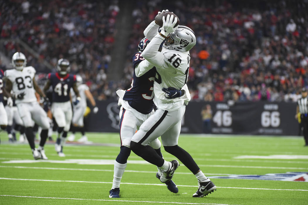 Oakland Raiders wide receiver Tyrell Williams (16) is hit by Houston Texans defensive back Keio ...
