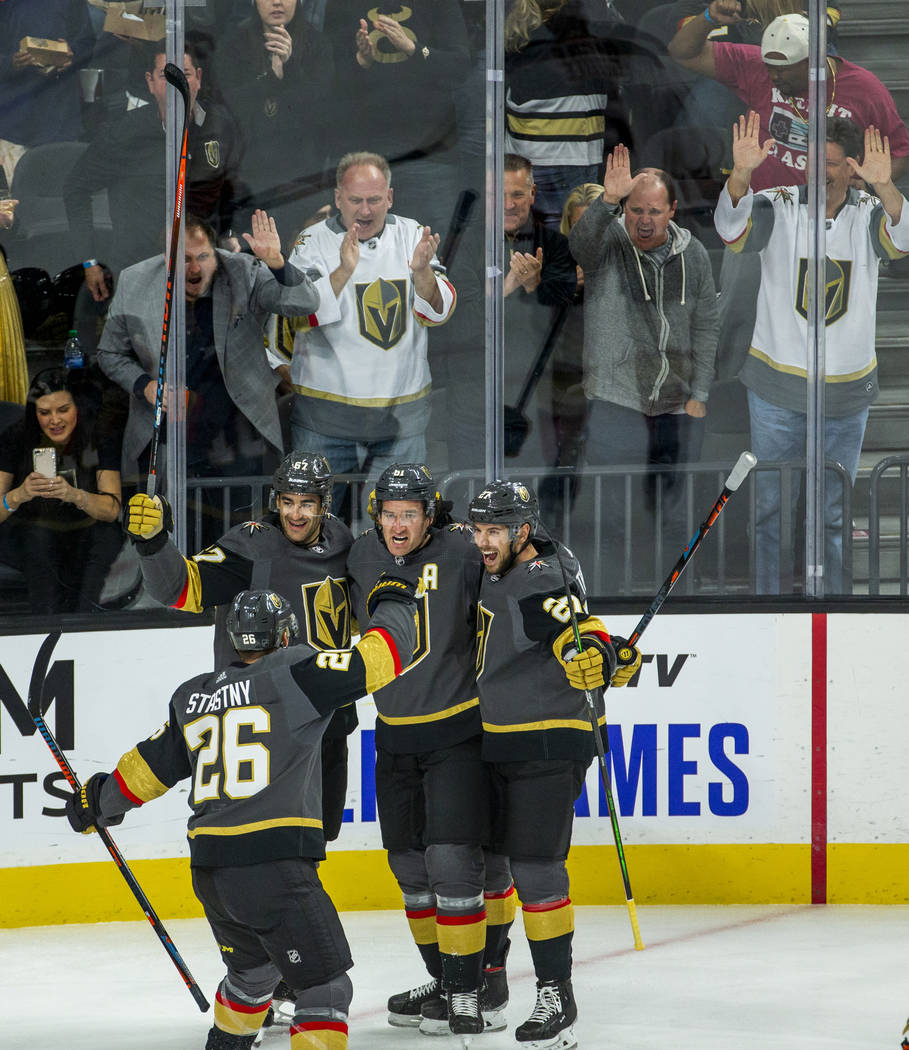 Vegas Golden Knights right wing Mark Stone (61, center) and teammates celebrate his goal over t ...
