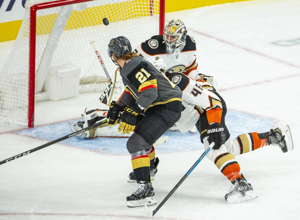 Vegas Golden Knights center Cody Eakin (21) sends a shot to the net but hits the post versus An ...