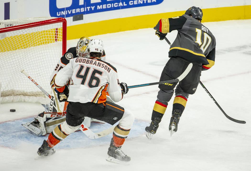 Vegas Golden Knights center Nicolas Roy (10) scores his first goal over Anaheim Ducks goaltende ...