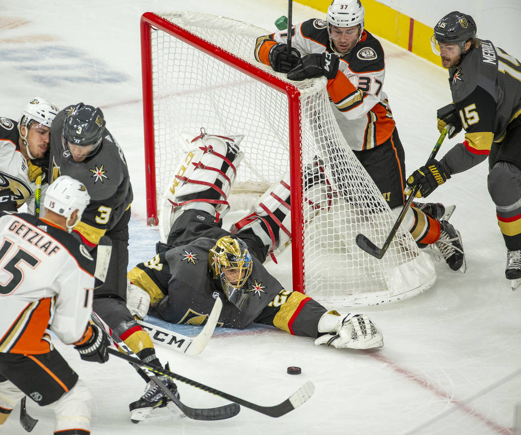 Vegas Golden Knights goaltender Marc-Andre Fleury (29) dives to recover a puck shot from the An ...