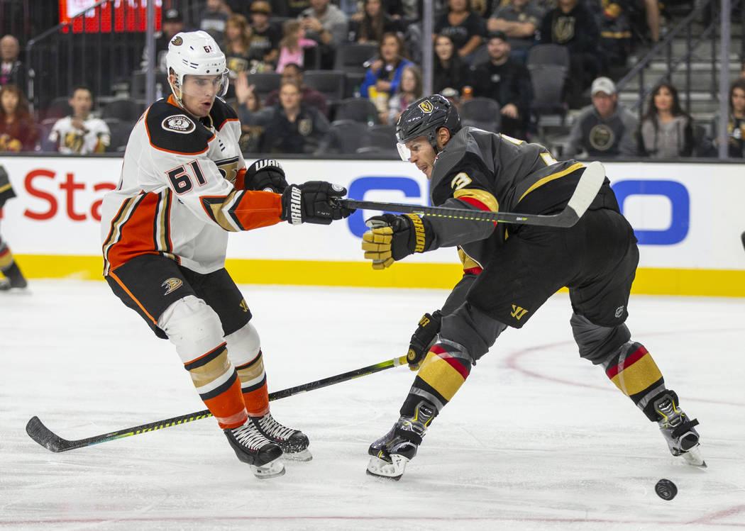 Anaheim Ducks center Troy Terry (61) has a shot deflected by Vegas Golden Knights defenseman Br ...
