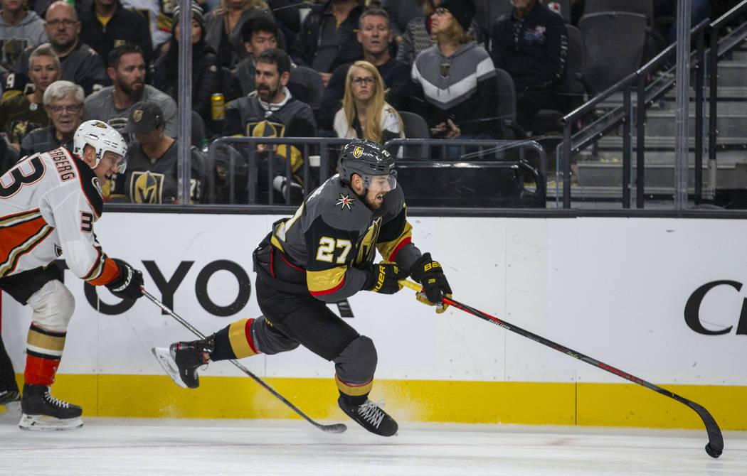 Anaheim Ducks right wing Jakob Silfverberg (33) trips up Vegas Golden Knights defenseman Shea T ...