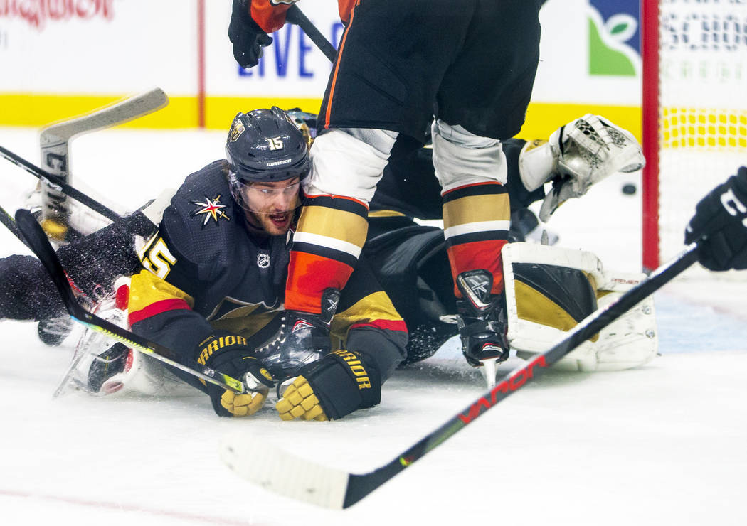 Vegas Golden Knights defenseman Jon Merrill (15) goes to the ice to help to deflect a shot on g ...