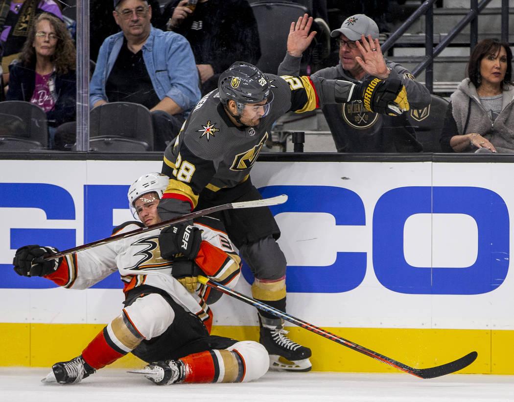 Anaheim Ducks center Sam Steel (34) is taken down by Vegas Golden Knights left wing William Car ...