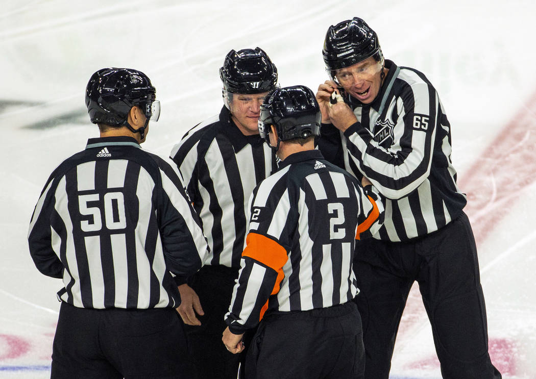 On ice officials come together as they ready to call the Vegas Golden Knights versus Anaheim Du ...