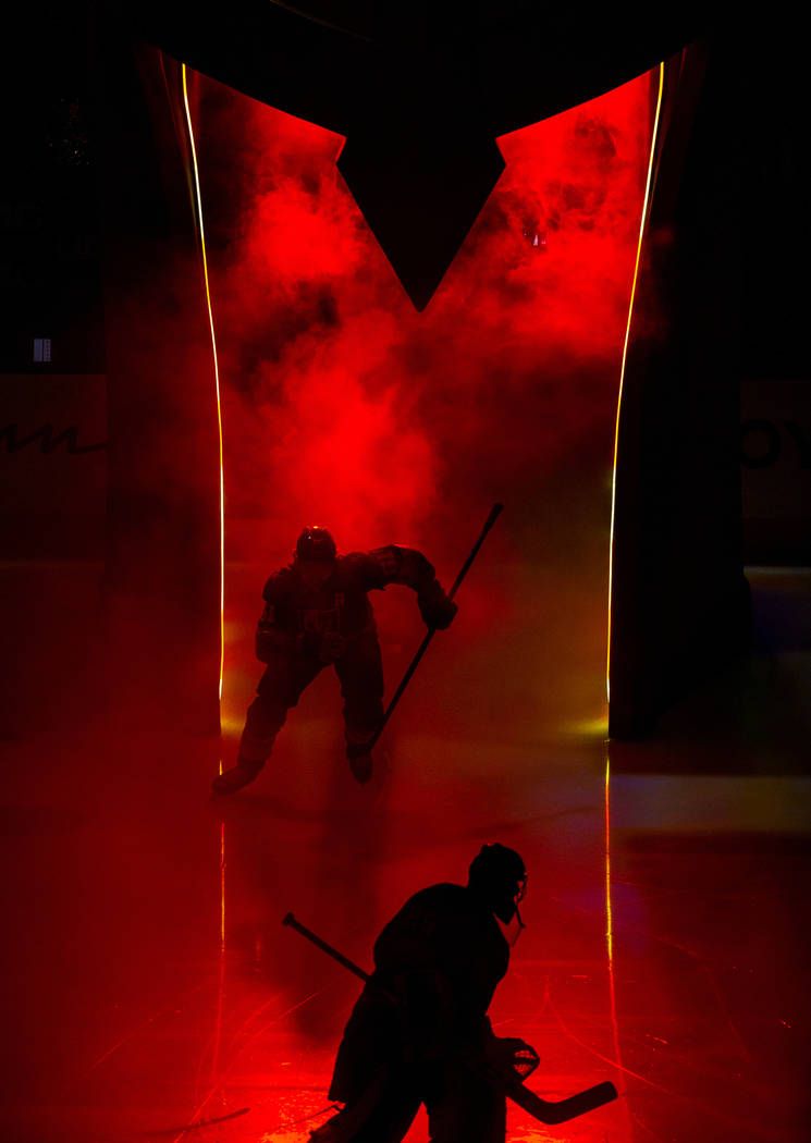 Vegas Golden Knights right wing Mark Stone (61) enters the ice through the helmet as Vegas Gold ...