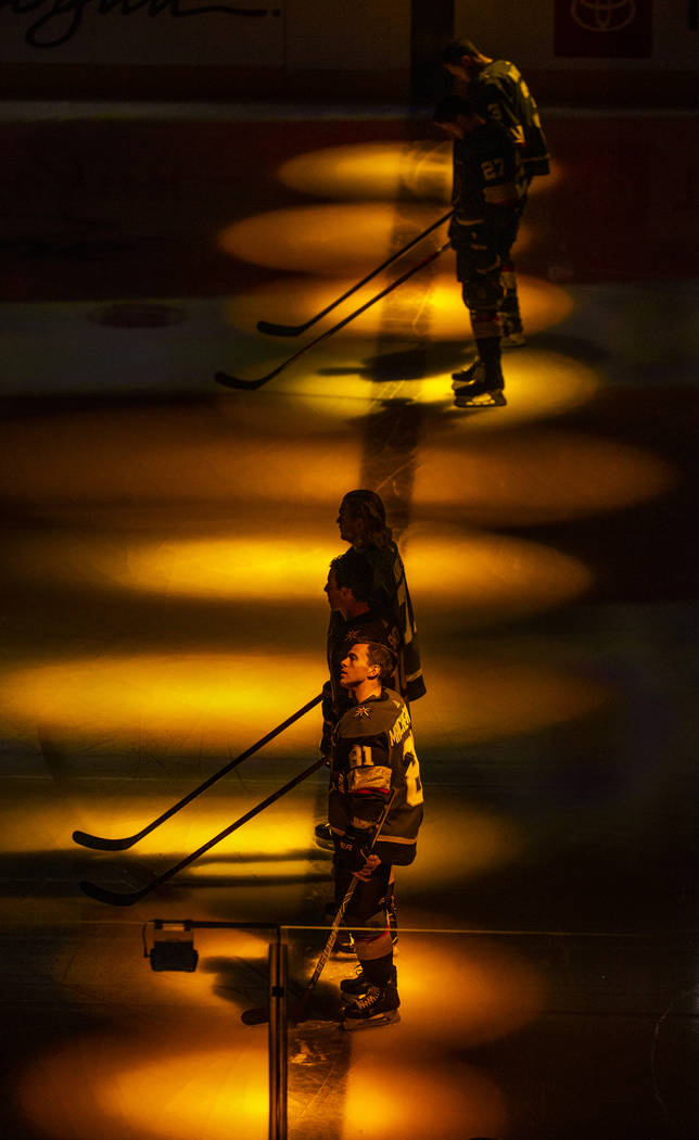 Vegas Golden Knights center Jonathan Marchessault (81) and teammates are bathed in golden light ...