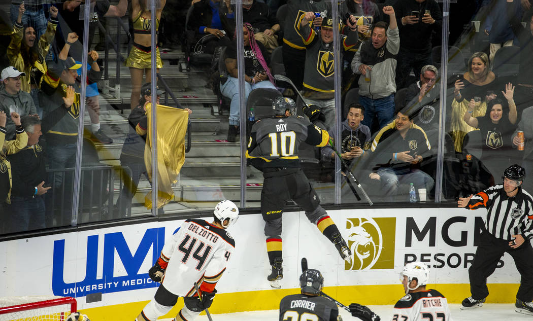 Vegas Golden Knights center Nicolas Roy (10) jumps into the glass while celebrating his first t ...