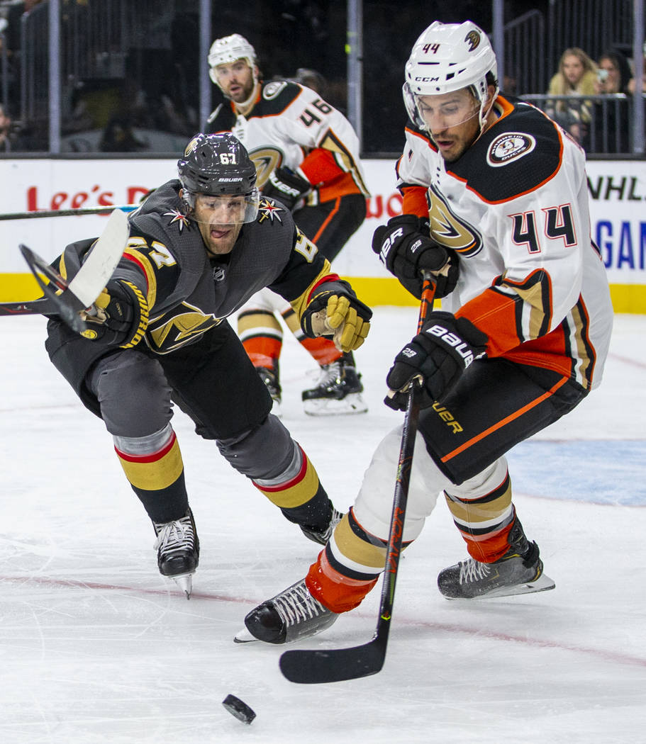 Vegas Golden Knights left wing Max Pacioretty (67) fights to get to the puck with Anaheim Ducks ...