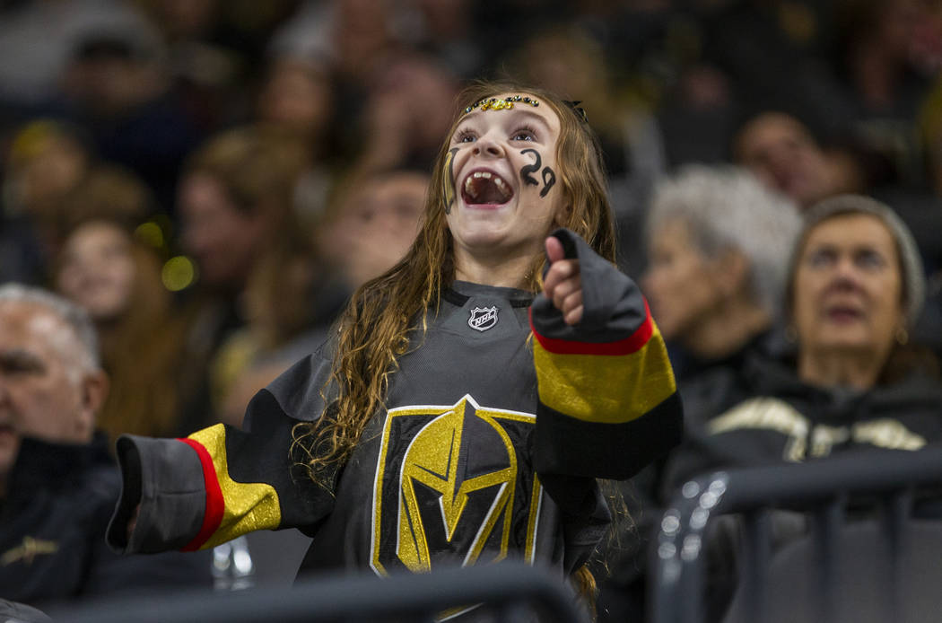 A Vegas Golden Knights fan see herself on the big screen as the team faces the Anaheim Ducks du ...