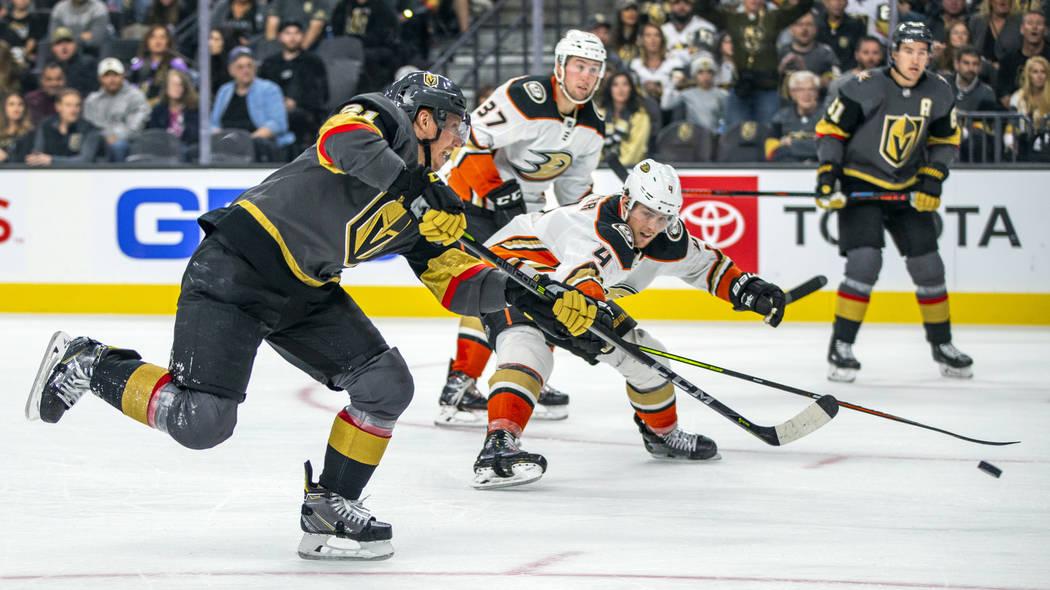 Vegas Golden Knights center Cody Eakin (21) fires a shot at goal past Anaheim Ducks defenseman ...