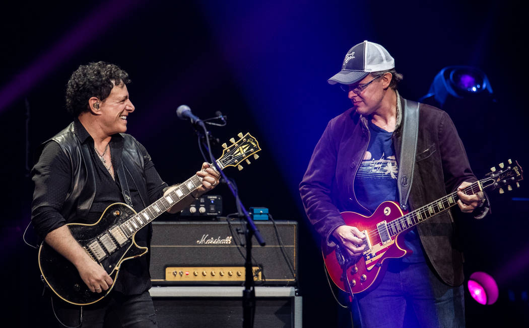 Neal Schon and Joe Bonamassa are shown at Journey's show at the Colosseum at Caesars Palace on ...