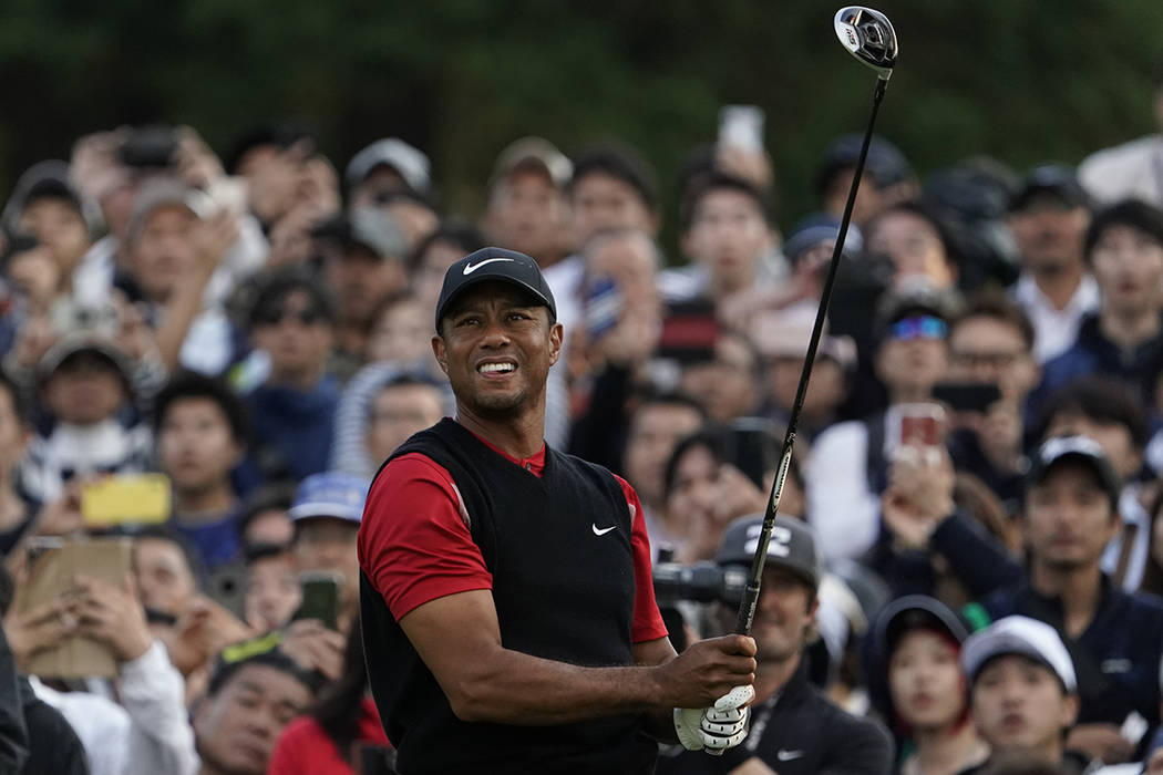 Tiger Woods of the United States watches his tee shot on the 8th hole during the final round of ...