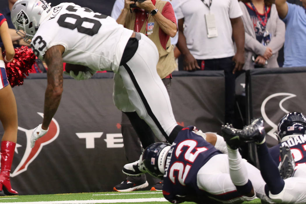 Oakland Raiders tight end Darren Waller (83) tries to shed a tackle from Houston Texans cornerb ...
