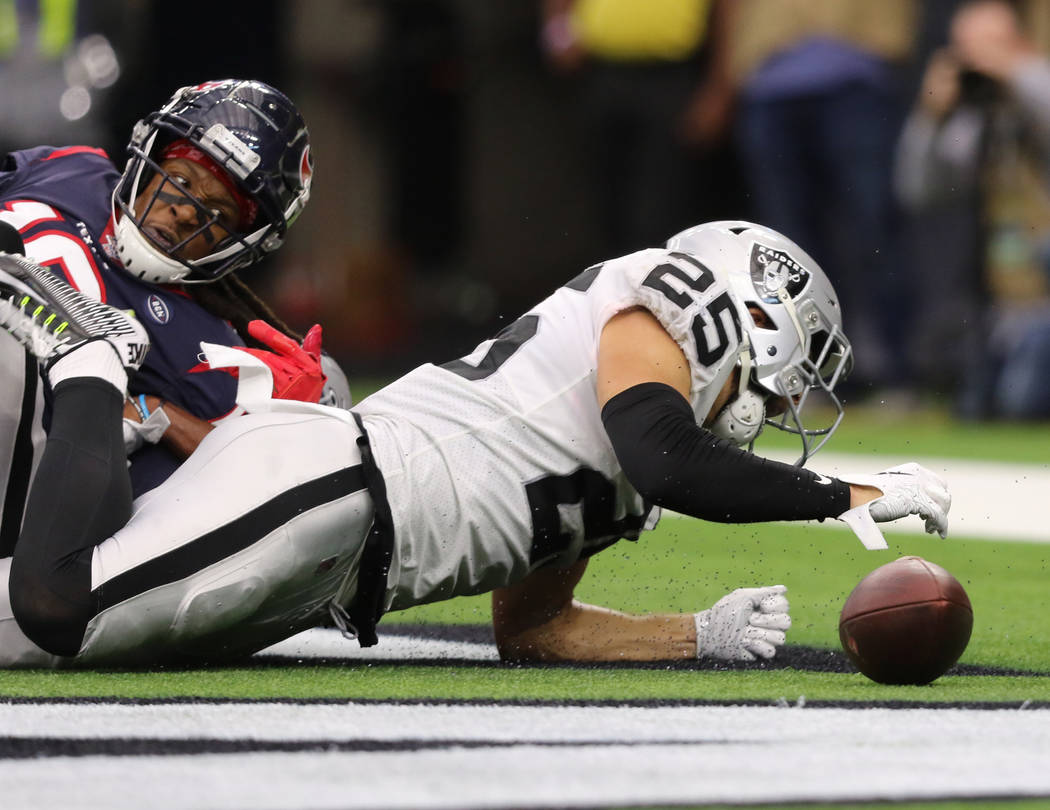 Oakland Raiders free safety Erik Harris (25) deflects a pass intended for Houston Texans wide r ...
