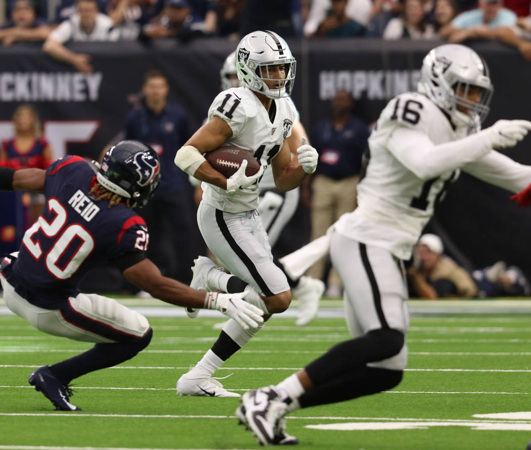 Oakland Raiders wide receiver Trevor Davis (11) runs after making a catch as Houston Texans str ...
