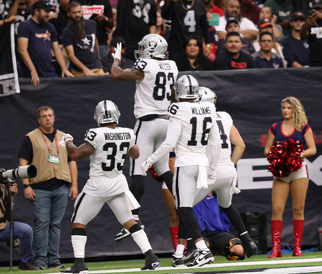 Oakland Raiders tight end Darren Waller (83) celebrates his touchdown with running back DeAndre ...