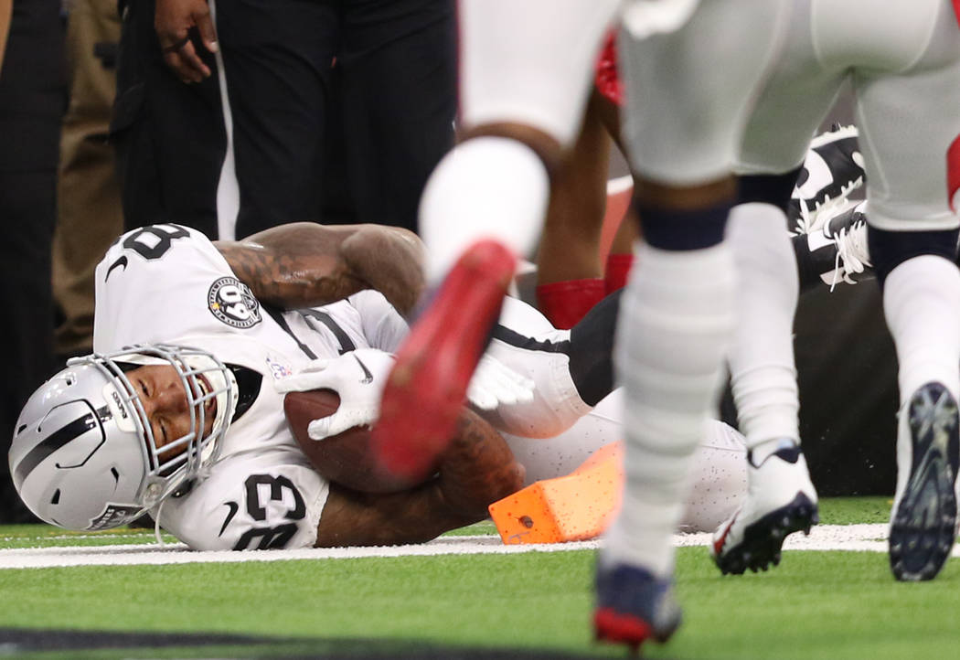Oakland Raiders tight end Darren Waller (83) scores a touchdown during the first half of an NFL ...