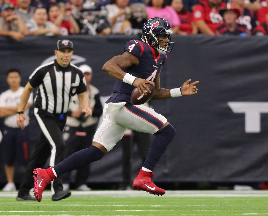 Houston Texans quarterback Deshaun Watson (4) runs with the football during the first half of a ...