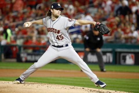 Houston Astros starting pitcher Gerrit Cole throws against the Washington Nationals during the ...