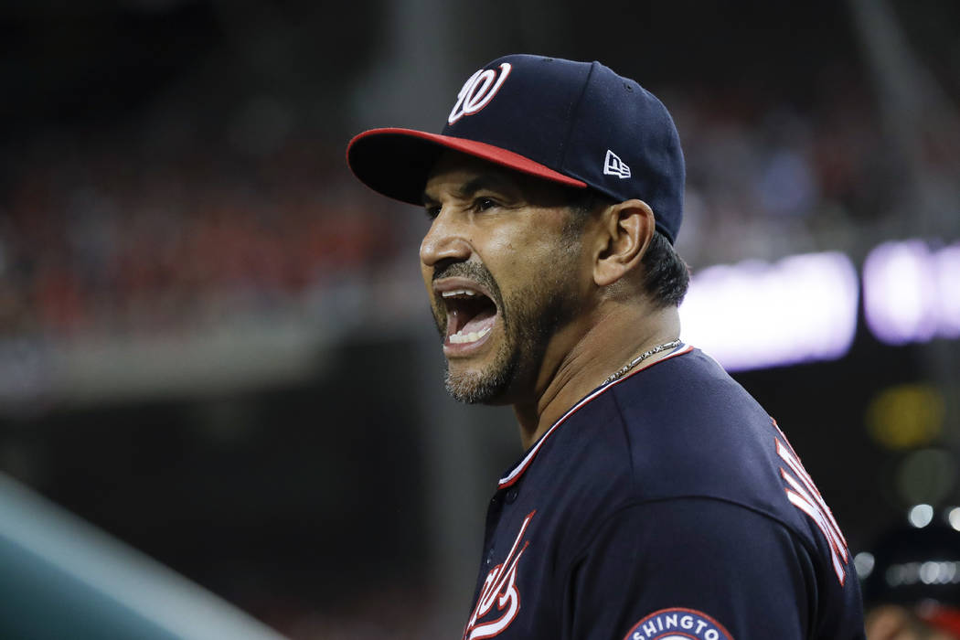 Washington Nationals manager Dave Martinez yells at the home plate umpire during the seventh in ...