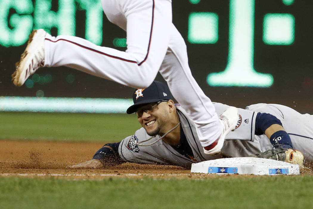 Houston Astros first baseman Yuli Gurriel forces out Washington Nationals' Trea Turner at first ...