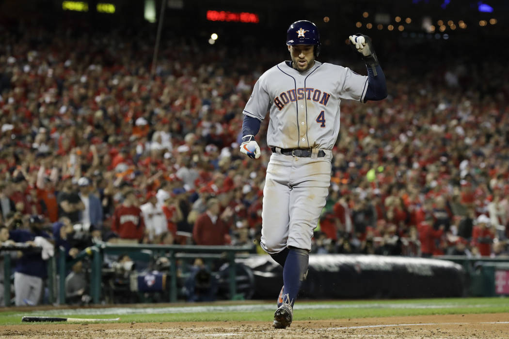 Houston Astros' George Springer celebrates after scoring on a dingle by Yuli Gurriel during the ...