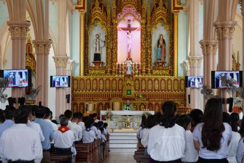 Priest Nguyen Duc Vinh leads a Sunday Mass at Phu Tang church in Yen Thanh district, Nghe An pr ...