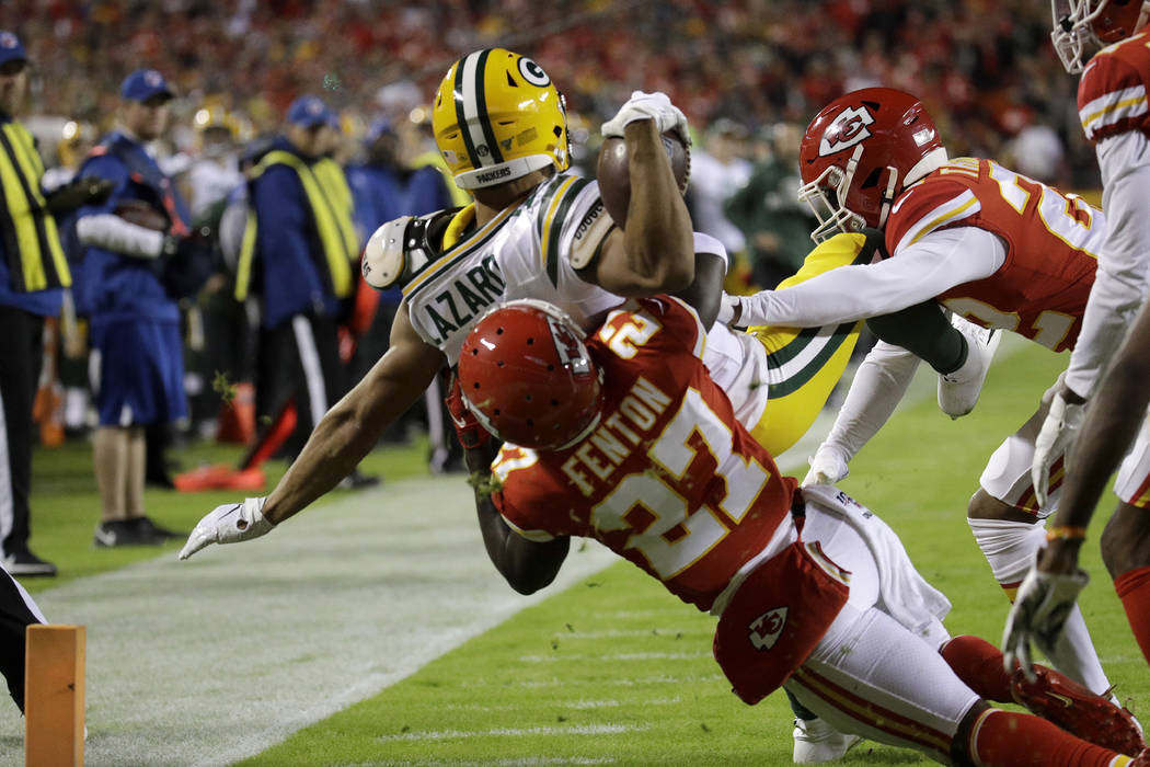 Green Bay Packers wide receiver Allen Lazard (13) is tackled by Kansas City Chiefs cornerback R ...
