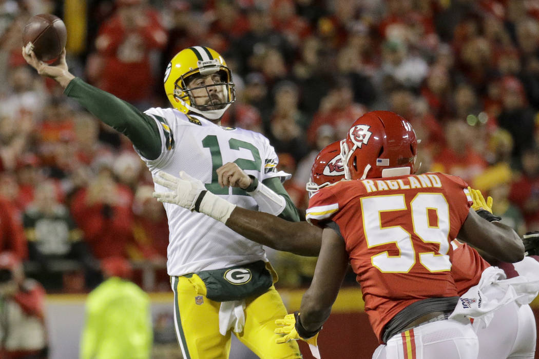 Green Bay Packers quarterback Aaron Rodgers (12) throws a pass under pressure from Kansas City ...