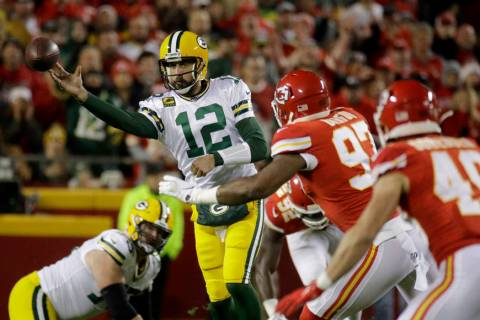 Green Bay Packers quarterback Aaron Rodgers (12) throws a pass against Kansas City Chiefs defen ...
