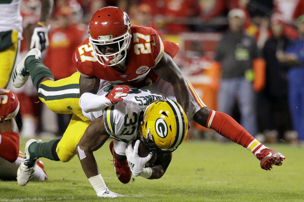 Green Bay Packers running back Aaron Jones (33) is tackled by Kansas City Chiefs cornerback Ras ...