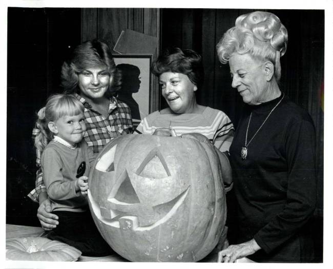 Four generations of pumpkin carvers, but only one who knows how to cheese for the camera. (Scot ...