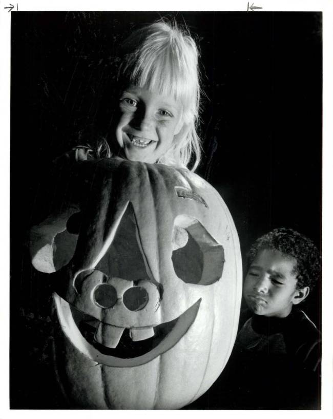 Lyn Maring, 6, grins, showing similar a dental arrangement of Halloween pumpkin and herself whi ...