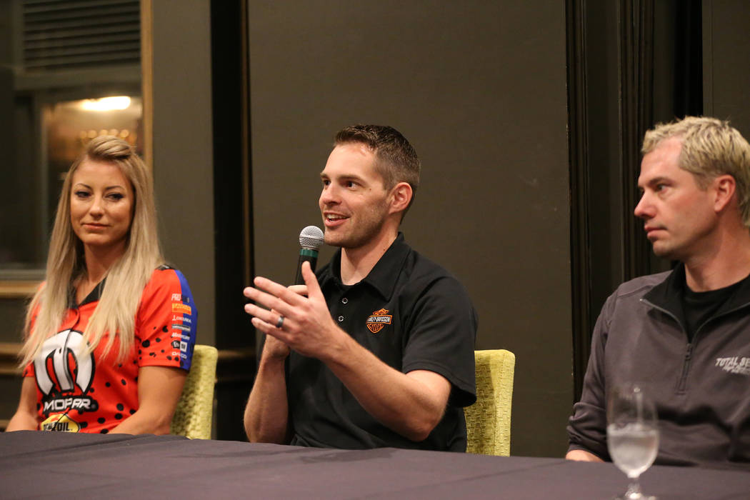 Drivers Andrew Hines, center, with Leah Pritchett, left, and Matt Hartford, speaks during a pre ...