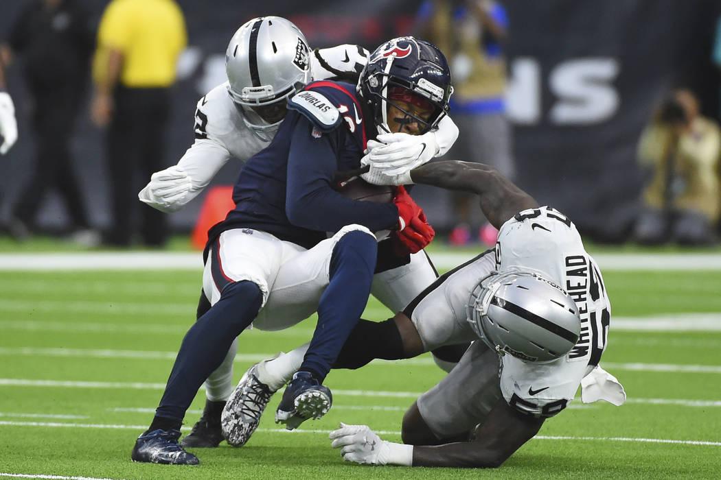 Houston Texans wide receiver DeAndre Hopkins (10) is hit by Oakland Raiders outside linebacker ...