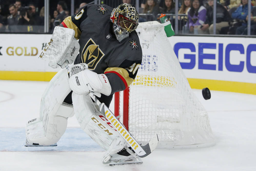 Vegas Golden Knights goaltender Malcolm Subban knocks the puck away during the first period of ...