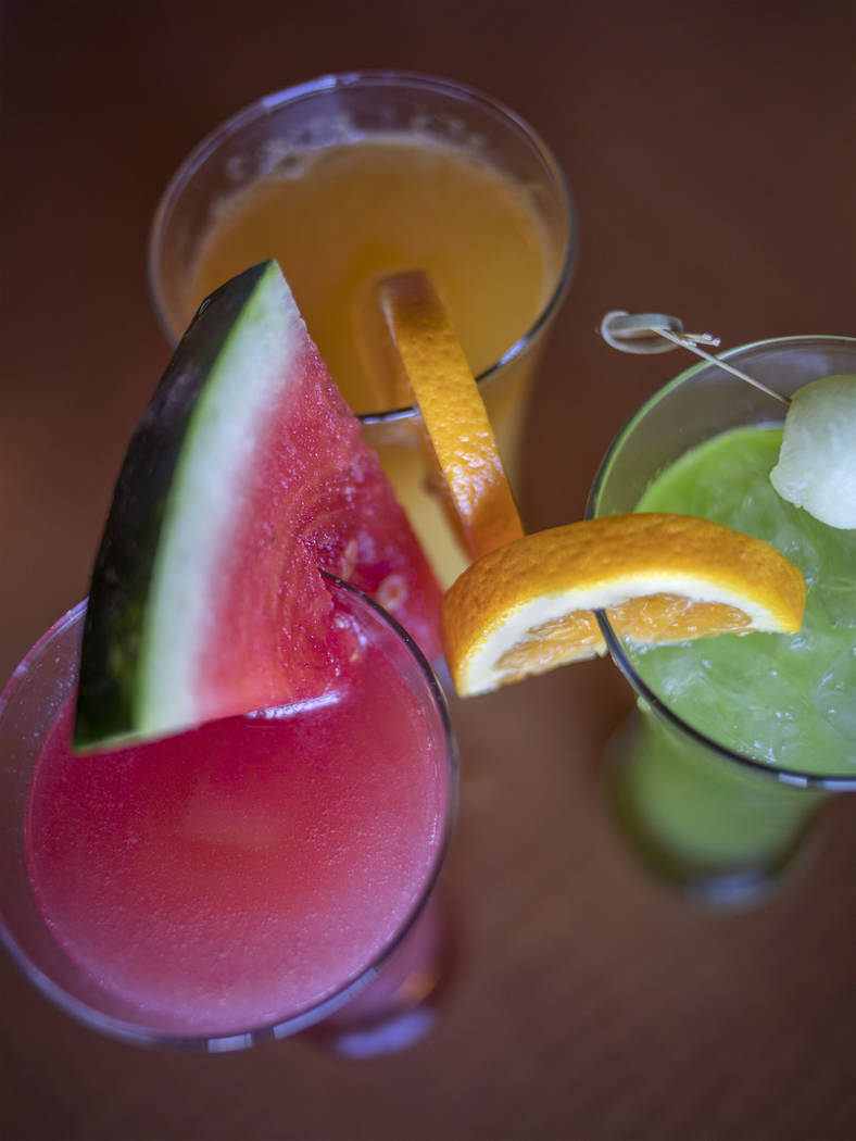 Mimosas made from fresh juices of watermelon, melon and orange at Rise & Shine in the Southern ...