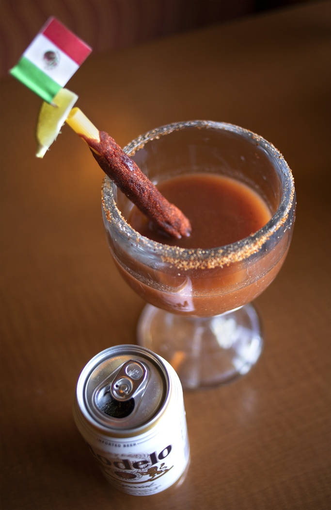 Rise & Shine's homemade Michelada is adorned with a Mexican flag, Modelo beer and rimmed with h ...