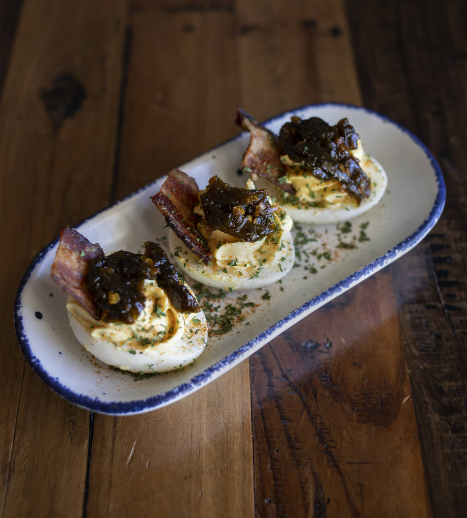 Wicked Deviled Eggs run 3 for $4.95 or 6 for $8.95 on the menu at Mama Bird in the Southern Hig ...