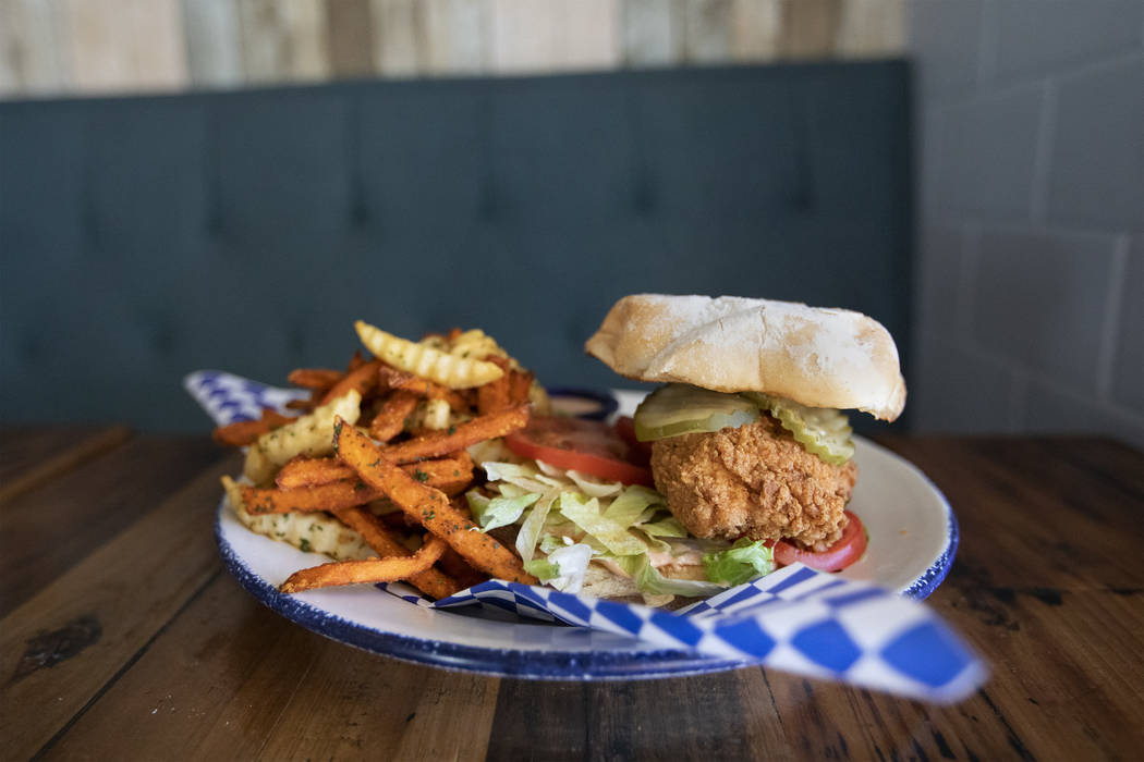 Mama Bird's fried chicken sandwich sits high on a potato roll at the restaurant on Friday, Oct. ...