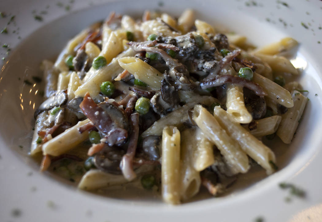 Speck, a pasta dish at Spaghetty Western, includes mushrooms, peas, smoked prosciutto and a fou ...