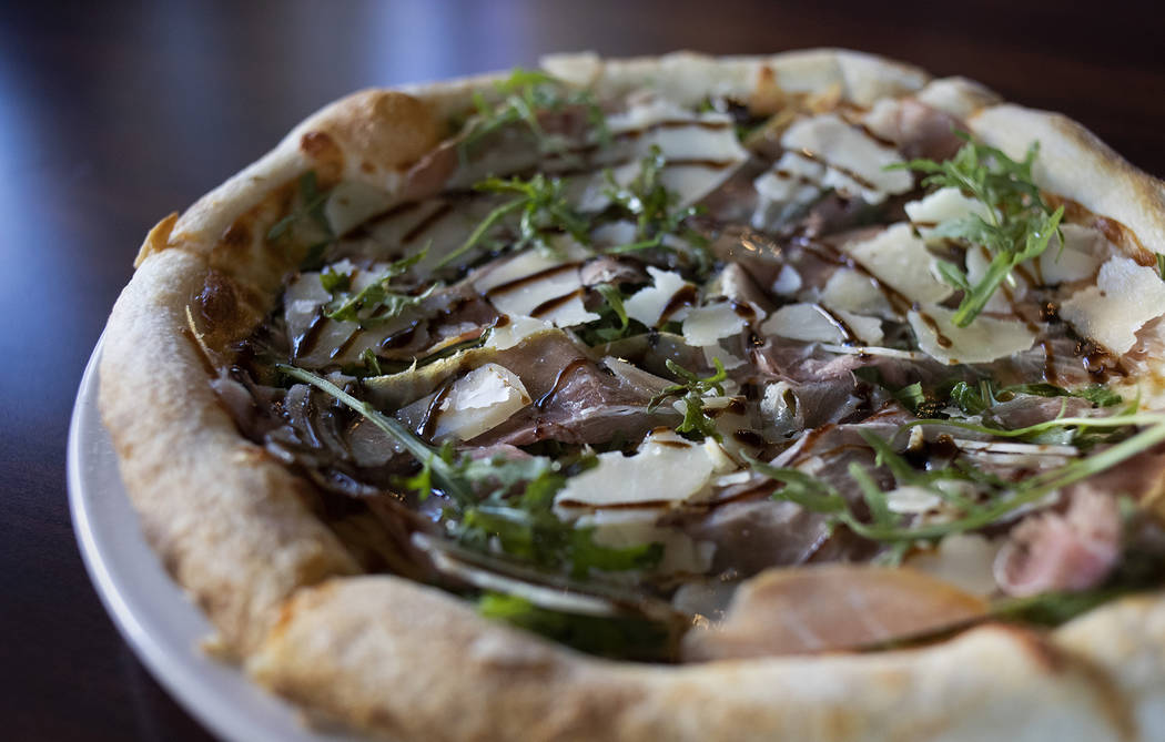 """The """"San Daniele"""" pizza, named for the shaved San Daniele prosciutto as the star ingredient, at ..."""