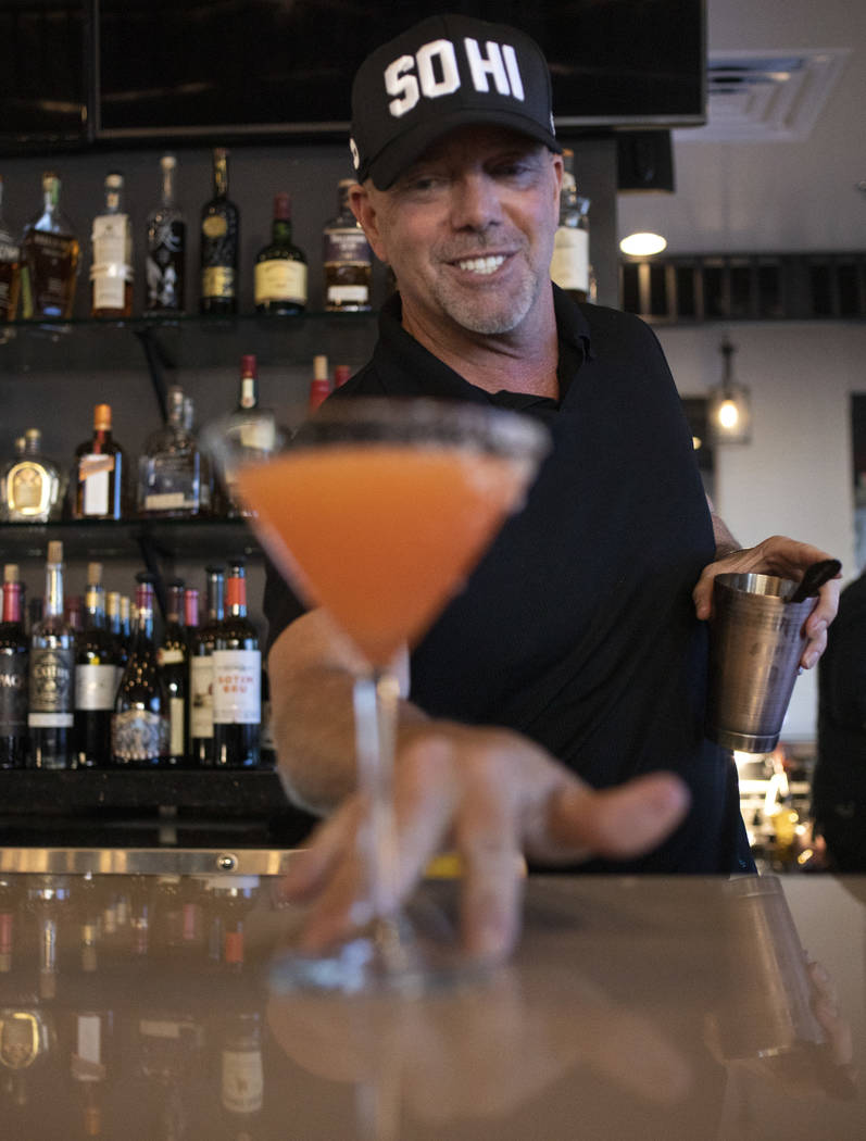 Bartender lead David Cooper pours an aperitif with fresh grapefruit juice and bitters at Spaghe ...