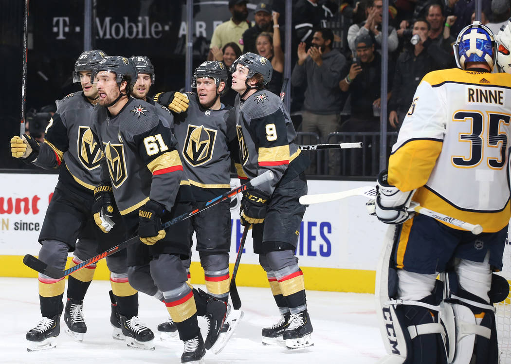 Vegas Golden Knights right wing Mark Stone (61) celebrates with teammates after scoring a goal ...
